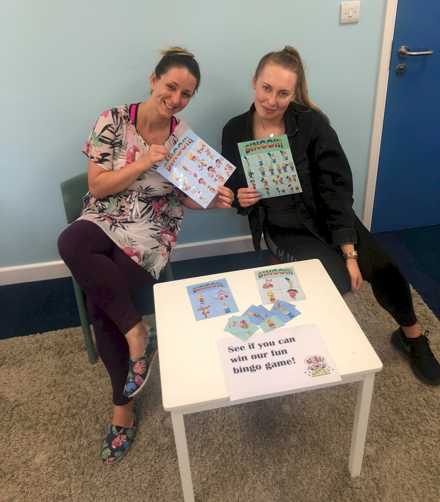 Researchers, Judit and Beth, show off the bingo game